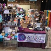 SPARKLE Studio booth at a fiber festival