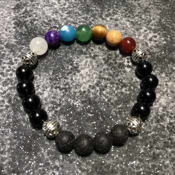 Aromatherapy Energy BraceletBracelet featuring one bead for each of the 7 chakras plus lava stone, black jasper, and silvertone beads
