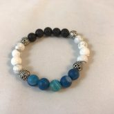 Crown chakra aromatherapy bracelet with blue agate, white howlite, and lavastone beads