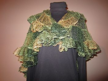 Front view of Nautilus Shawl crocheeted in autumn colors