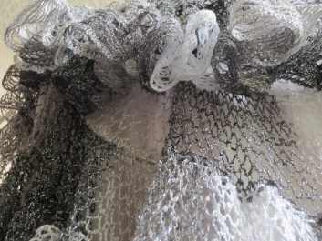 Closeup of Nautilus Shawl crocheted in shades of white, gray, and black