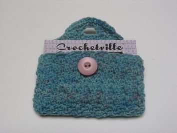 Crocheted Business Card Case, open with business card