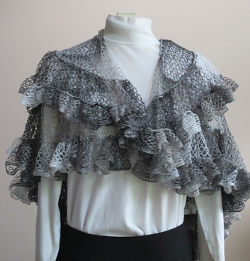Front view of Nautilus Shawl crocheted in shades of white, gray, and black