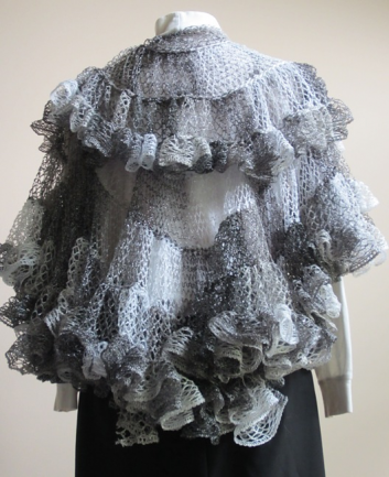Back view of Nautilus Shawl crocheted in shades of white, gray, and black