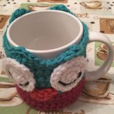 Janus the Owl Coffee Cup Cozy, both eyes closed