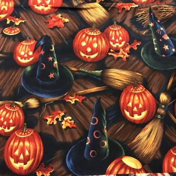 fabric with blue witch hats and orange jack-o-lanterns