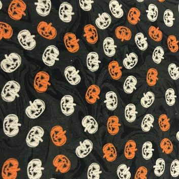 cream and orange pumpkins on black background