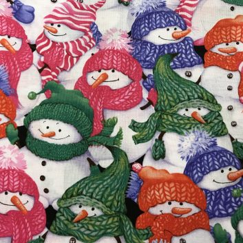 fabric with snowmen wearing knitting hats and scarves