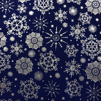 fabric with metallic silver snowflakes on dark blue background