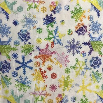 fabric with rainbow colored snowflakes on white background