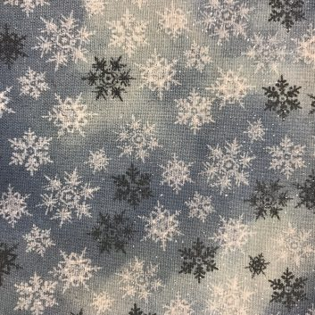 fabric with sparkly snowflakes on blue background