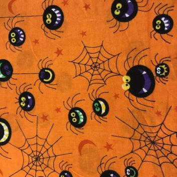fabric with black spiders and webs on orange background