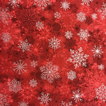 fabric with white snowflakes on red background