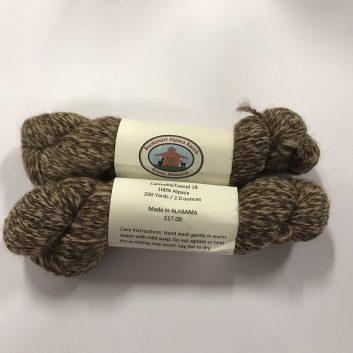 2 skeins of brown and cream alpaca yarn